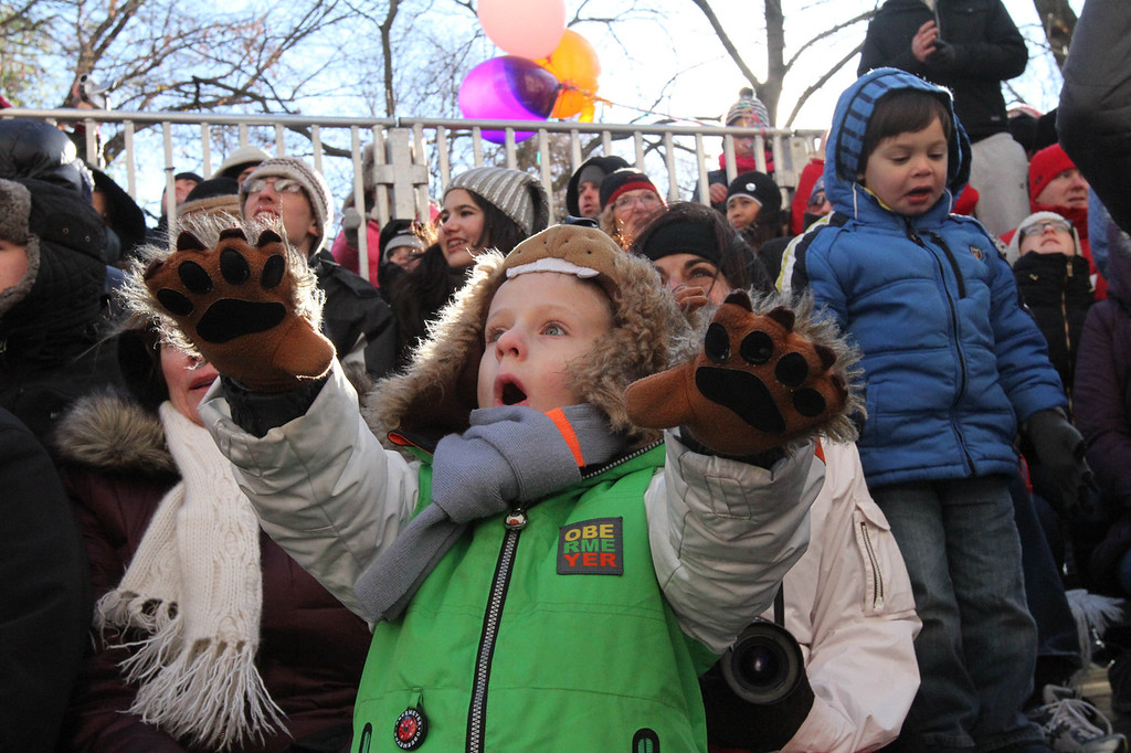 . Logan Berg, 5, of Mount Olive, New Jersey, foreground, reacts as he and others watch the Macy\'s Thanksgiving Day Parade as it makes it\'s way down New York\'s Central Park West, Thursday, Nov. 28, 2013. (AP Photo/Tina Fineberg)