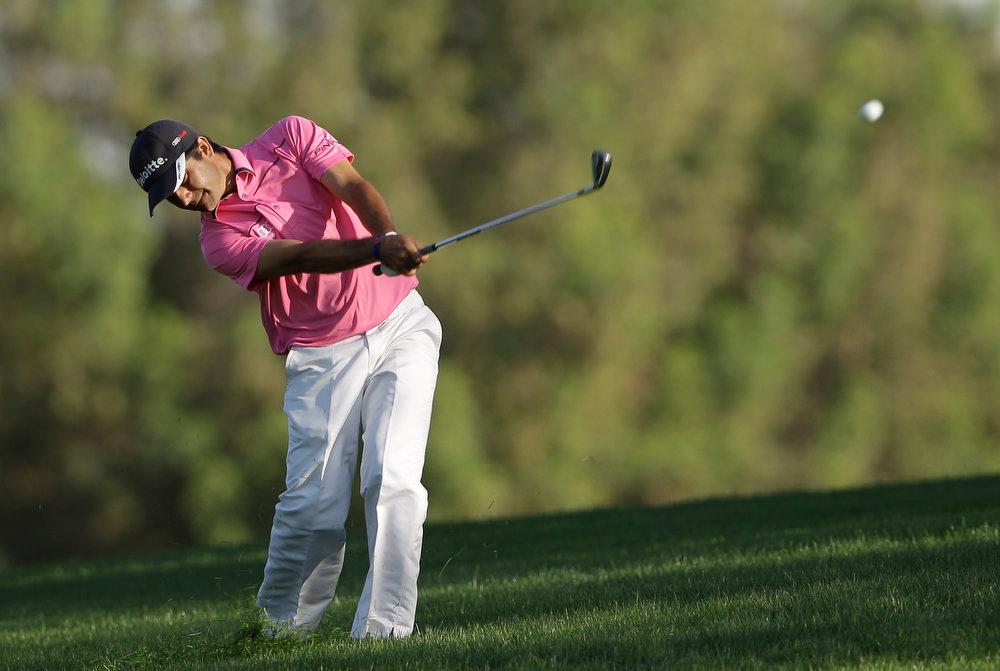 . Felipe Aguilar from Chile plays a ball on the 18th hole during the final round of the Dubai Desert Classic Golf tournament in Dubai, United Arab Emirates, Sunday, Feb. 3, 2013. (AP Photo/Kamran Jebreili)
