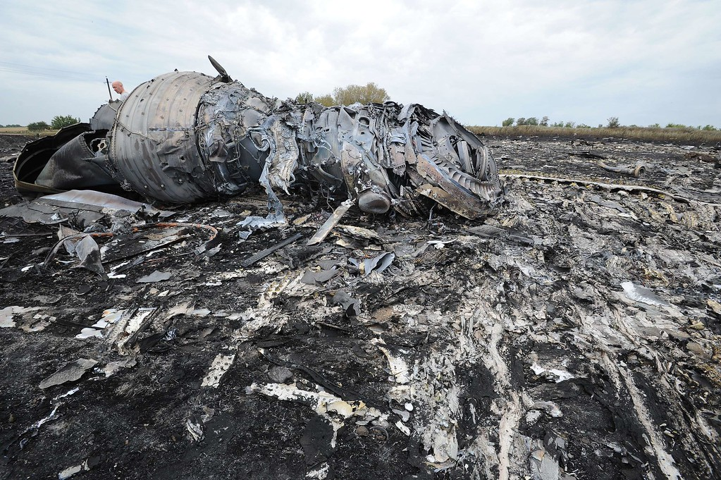 . A picture taken on July 18, 2014 shows the wreckages of the Malaysia Airlines jet carrying 298 people from Amsterdam to Kuala Lumpur a day after it crashed, near the town of Shaktarsk, in rebel-held east Ukraine. Pro-Russian rebels fighting central Kiev authorities claimed on July 17 that the Malaysian airline that crashed in Ukraine had been shot down by a Ukrainian jet. The head of Ukraine\'s air traffic control agency said Thursday that the crew of the Malaysia Airlines jet that crashed in the separatist east had reported no problems during flight. All 298 people on board Flight MH17 died when the plane crashed. AFP PHOTO/DOMINIQUE  FAGET/AFP/Getty Images