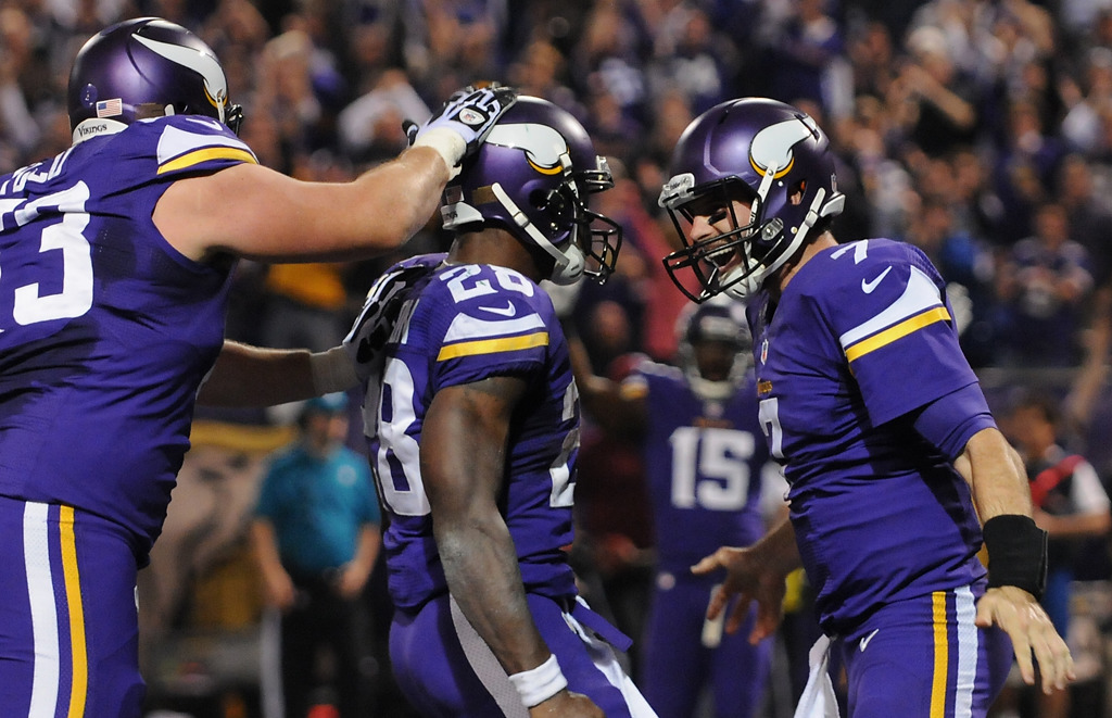 . Minnesota running back Adrian Peterson celebrates his touchdown with quarterback Christian Ponder in the second quarter. (Pioneer Press: John Autey)