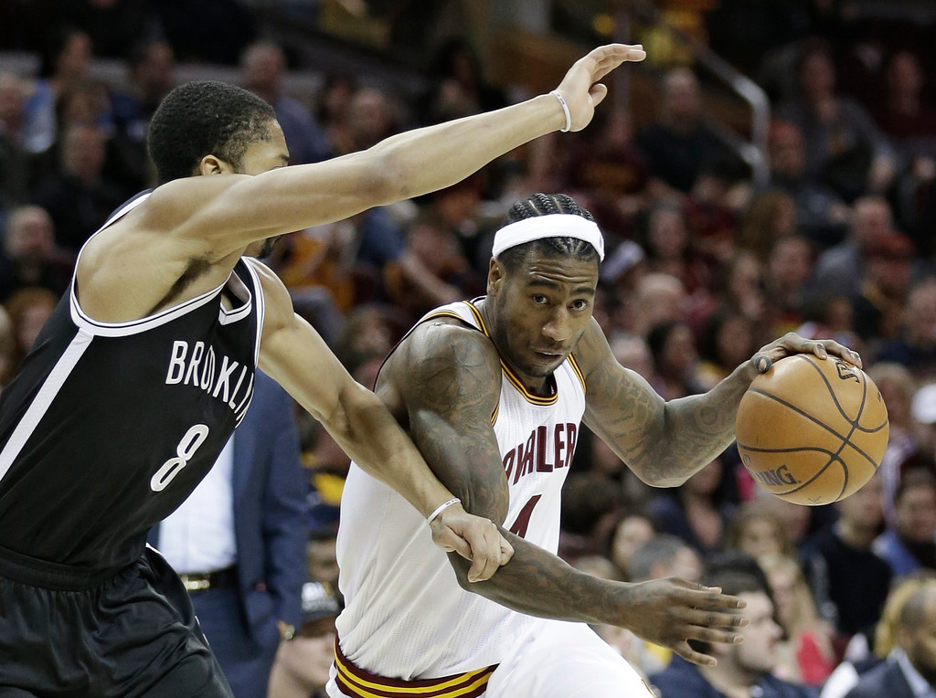 . Cleveland Cavaliers\' Iman Shumpert, right, drives against Brooklyn Nets\' Spencer Dinwiddie during the second half of an NBA basketball game, Friday, Jan. 27, 2017, in Cleveland. The Cavaliers won 124-116.(AP Photo/Tony Dejak)