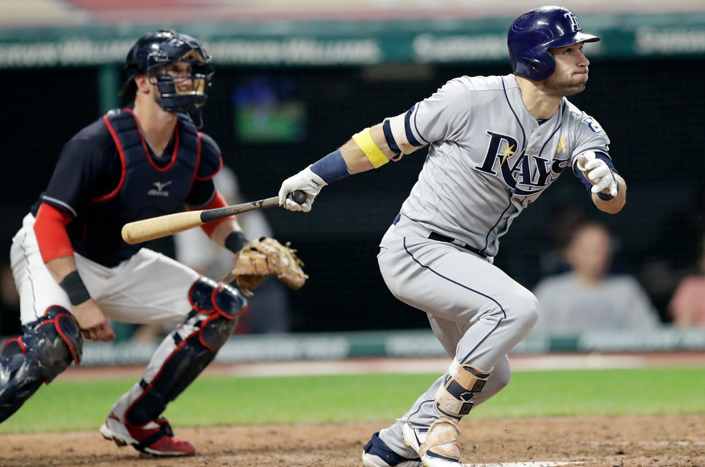 . Tampa Bay Rays\' Kevin Kiermaier watches his ball after hitting an RBI-single off Cleveland Indians relief pitcher Tyler Olson in the sixth inning of a baseball game, Saturday, Sept. 1, 2018, in Cleveland. Cleveland Indians catcher Yan Gomes watches. (AP Photo/Tony Dejak)