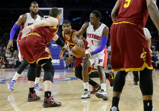 . Detroit Pistons guard Reggie Jackson (1) passes the ball during the second half of an NBA basketball game, Tuesday, Feb. 24, 2015 in Auburn Hills, Mich. Cleveland defeated the Pistons 102-93. (AP Photo/Carlos Osorio)