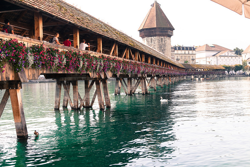 The Chapel Bridge (German: Kapellbrücke) is a covered wooden footbridge spanning diagonally across the Reuss River in the city of Lucerne