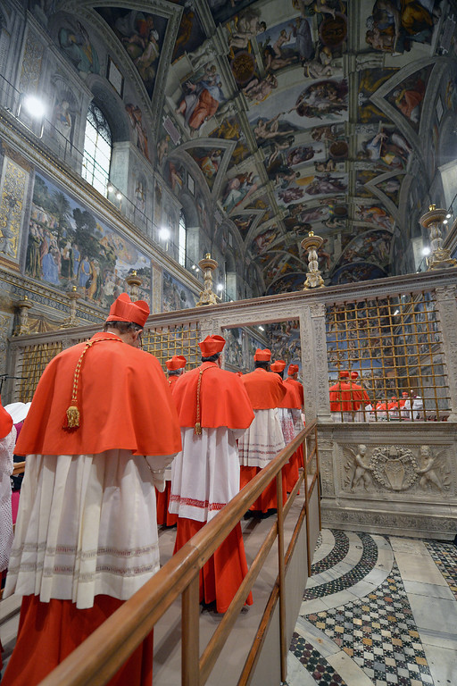". This handout picture released by the Press office shows cardinals arriving at the Sistine Chapel before the start of the conclave at the Vatican on March 12, 2013.   �AFP PHOTO/OSSERVATORE ROMANO""-/AFP/Getty Images"