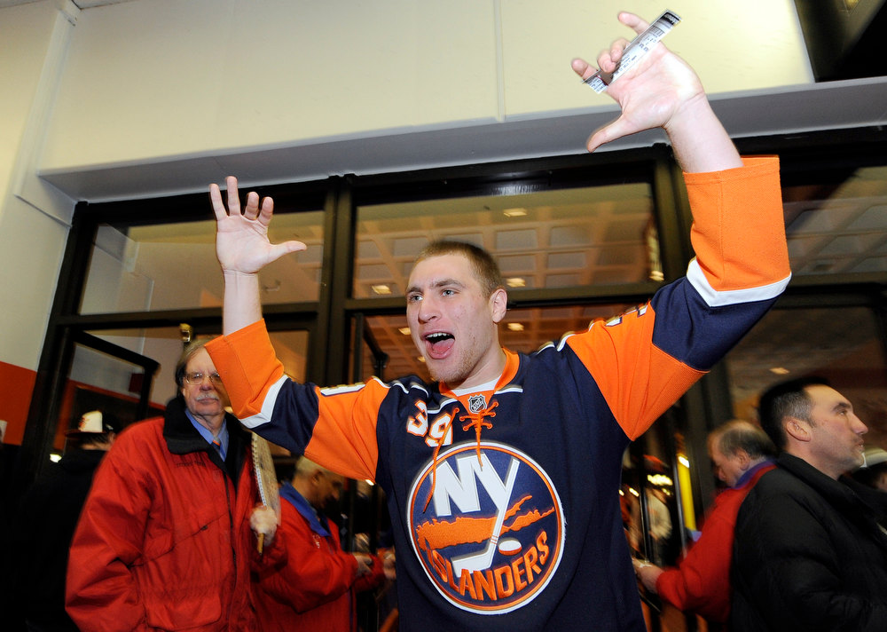 . Kevin Reinhardt of Hicksville, N.Y. cheers as he enters the Nassau Coliseum for New Jersey Devils versus the New York Islanders NHL hockey game for the opening of NHL hockey season on Saturday Jan., 19, 2013 at Nassau Coliseum  in Uniondale, N.Y. (AP Photo/Kathy Kmonicek)