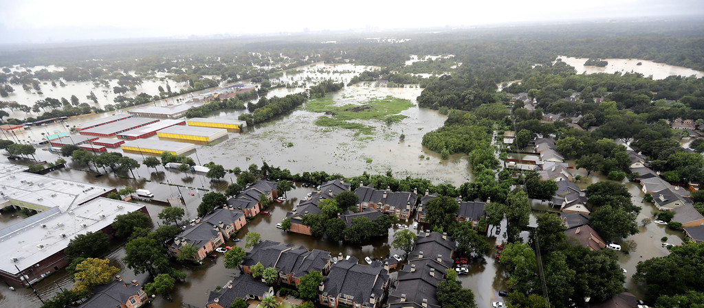 . Businesses and neighborhoods near Addicks Reservoir are flooded by rain from Tropical Storm Harvey Tuesday, Aug. 29, 2017, in Houston. (AP Photo/David J. Phillip)