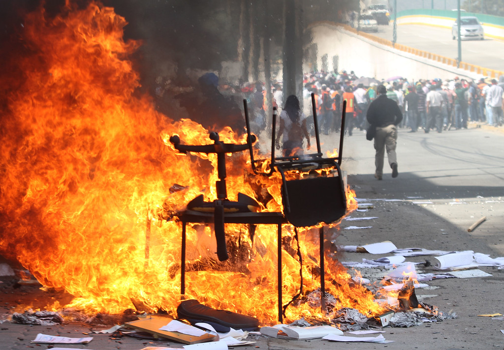 . Protesters set on fire the Education Secretarariat\'s Finance Office in Chilpancingo, Guerrero State, Mexico on November 12, 2014. Pedro PARDO/AFP/Getty Images