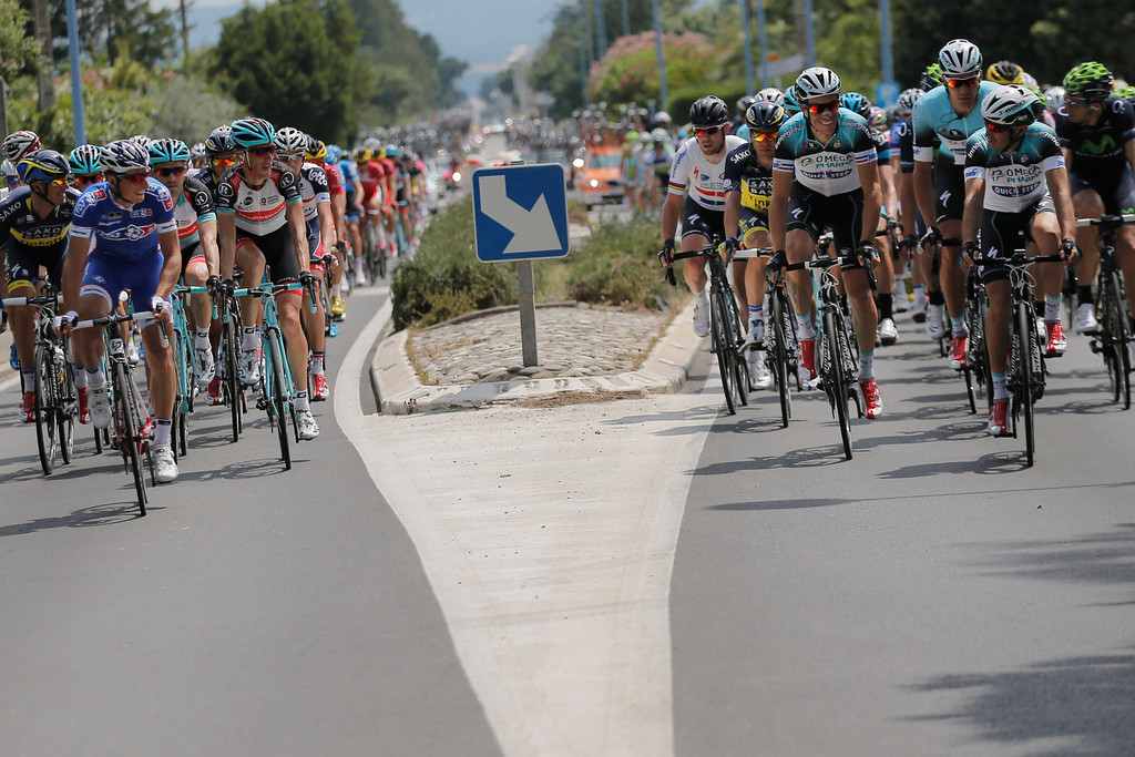 . The pack rides during the first stage of the Tour de France cycling race over 213 kilometers (133 miles) with start in Porto Vecchio and finish in Bastia, Corsica island, France, Saturday June 29, 2013. (AP Photo/Christophe Ena)