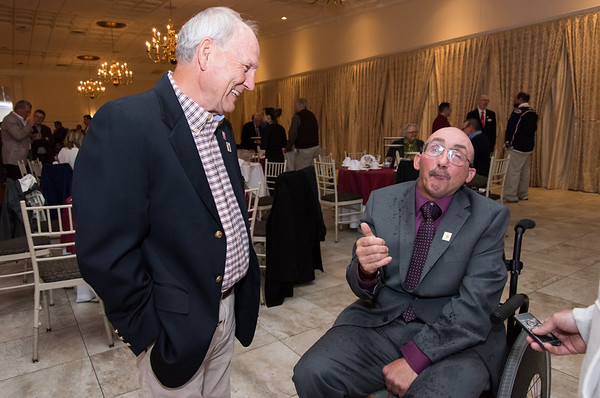 04/26/19 Wesley Bunnell | Staff Harrison McKinstry IV is the recipient of the Ron Choiniere Award for 2019 at The Bristol Tramps annual awards dinner on Friday night at the Aqua Turf Club. He was a wrestling team captain and football player at Bristol Central who was injured in a construction accident that has left him wheelchair bound. He currently competes in long distance road races using a special racing wheelchair. McKinstry jokes around with his ex wrestling coach Dennis Siegmann who coached for approximately 30 years and spent 8 years at principal at Bristol Central.