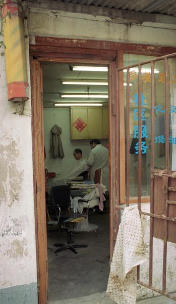 barber, community service, shanghai, china, 2005