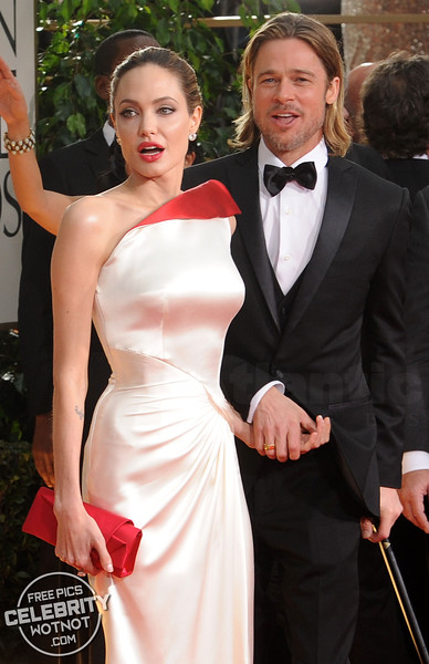 Angelina Jolie has to help injured Brad Pitt to walk on the red carpet at the Golden Globes, LA