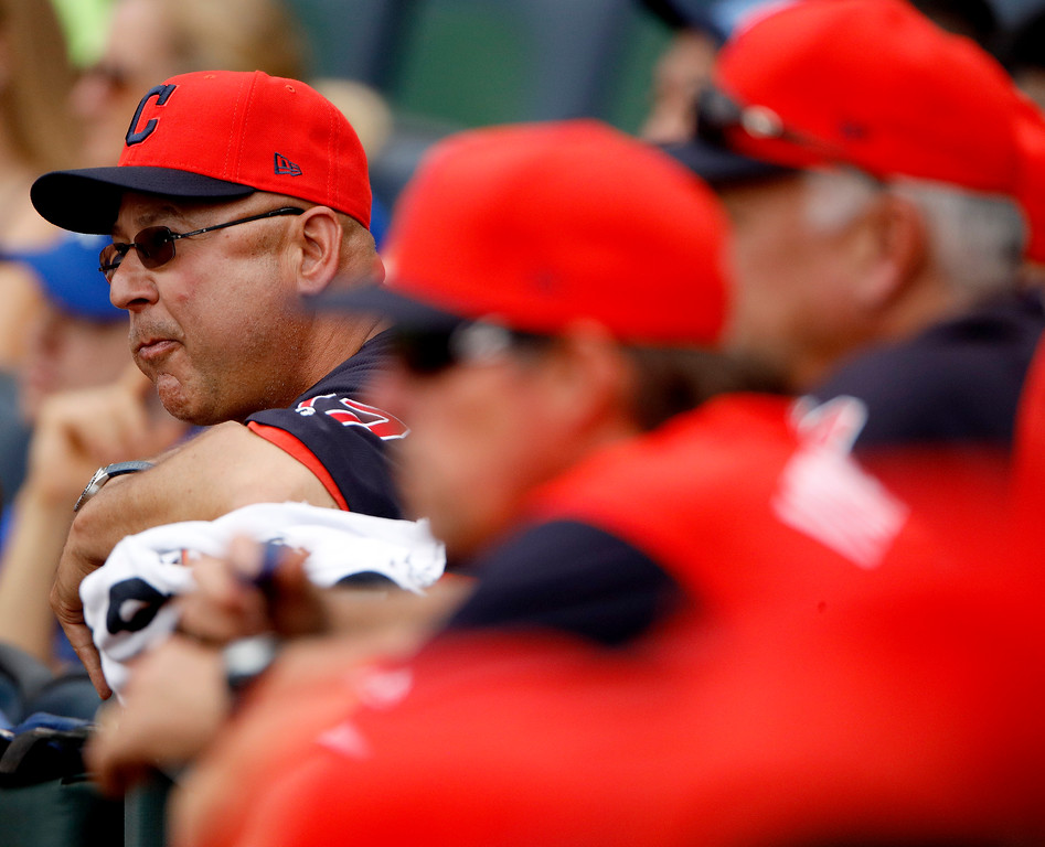 . Cleveland Indians manager Terry Francona watches from the dugout during the first inning of a baseball game against the Kansas City Royals Sunday, Aug. 26, 2018, in Kansas City, Mo. (AP Photo/Charlie Riedel)