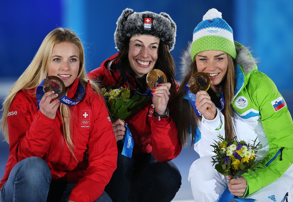 . Joint Gold medalists Tina Maze (R) of Slovenia and Dominique Gisin of Switzerland and bronze medalist Lara Gut of Switzerland (R) during the medal ceremony for the Women\'s Downhill race at the Sochi 2014 Olympic Games, Sochi, Russia, on February 12, 2014.  EPA/TATYANA ZENKOVICH