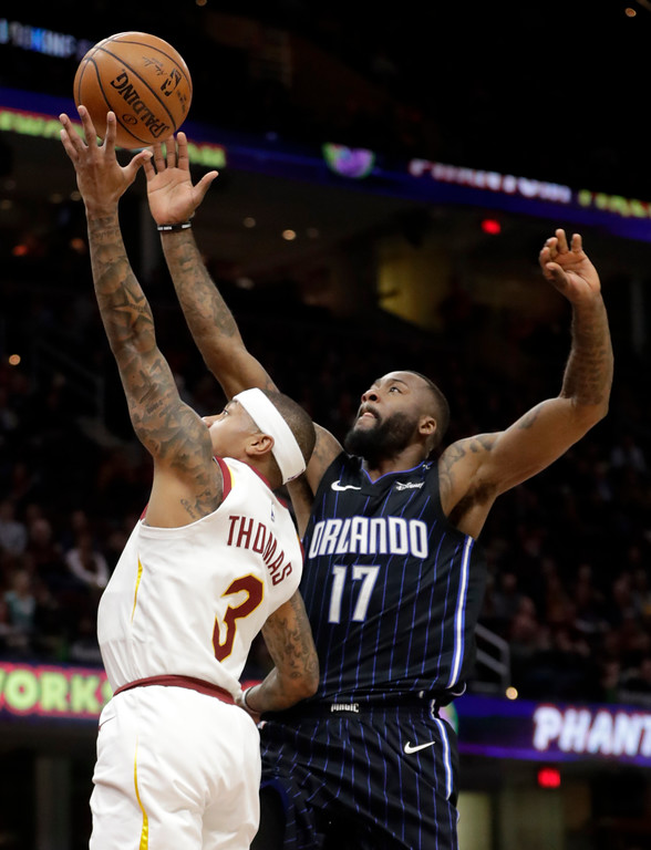 . Orlando Magic\'s Jonathon Simmons (17) blocks a shot by Cleveland Cavaliers\' Isaiah Thomas (3) in the first half of an NBA basketball game, Thursday, Jan. 18, 2018, in Cleveland. (AP Photo/Tony Dejak)