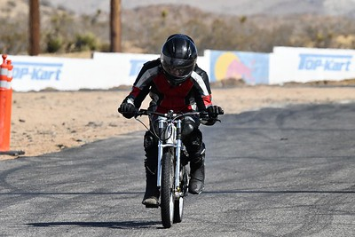 Black Helmet / Red-Black-White Suit