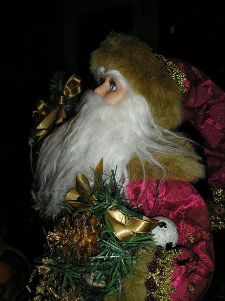 Santa keeps close tabs on the soccer ball.
