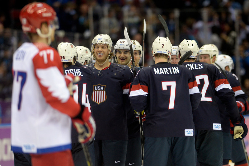 . The U.S.A. team celebrates after T.J. Oshiet (74) made the game-winning shot against Russia during  the U.S.A.\'s shootout-win at Bolshoy arena. Sochi 2014 Winter Olympics on Saturday, February 15, 2014. (Photo by AAron Ontiveroz/The Denver Post)