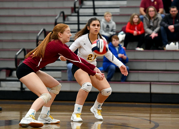 11/14/2019 Mike Orazzi | StaffrSt. Joseph High School's Brittany Mairano (2) and Kyra McCarthy (21) during the Class L Second Round Girls Volleyball Tournament at BCHS. rr