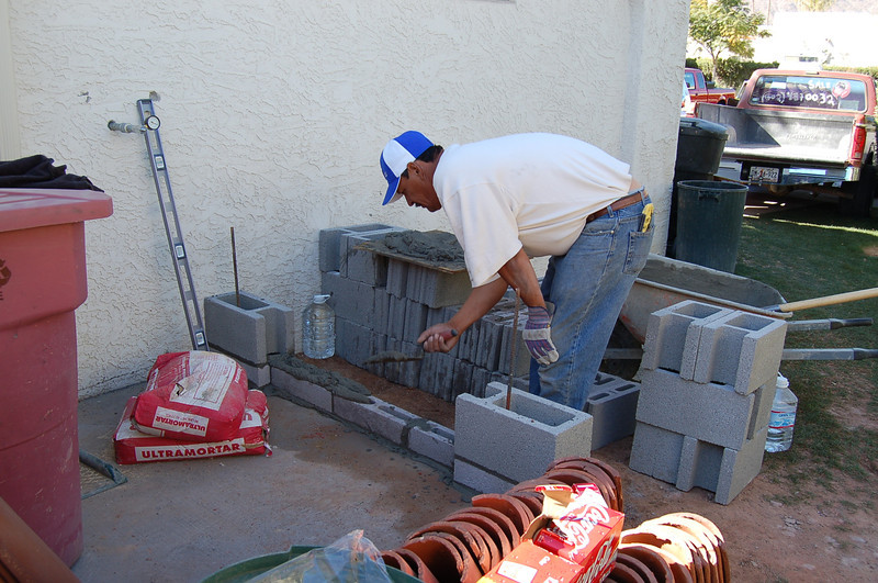 Building the wall that will shield the recycling and trash containers.