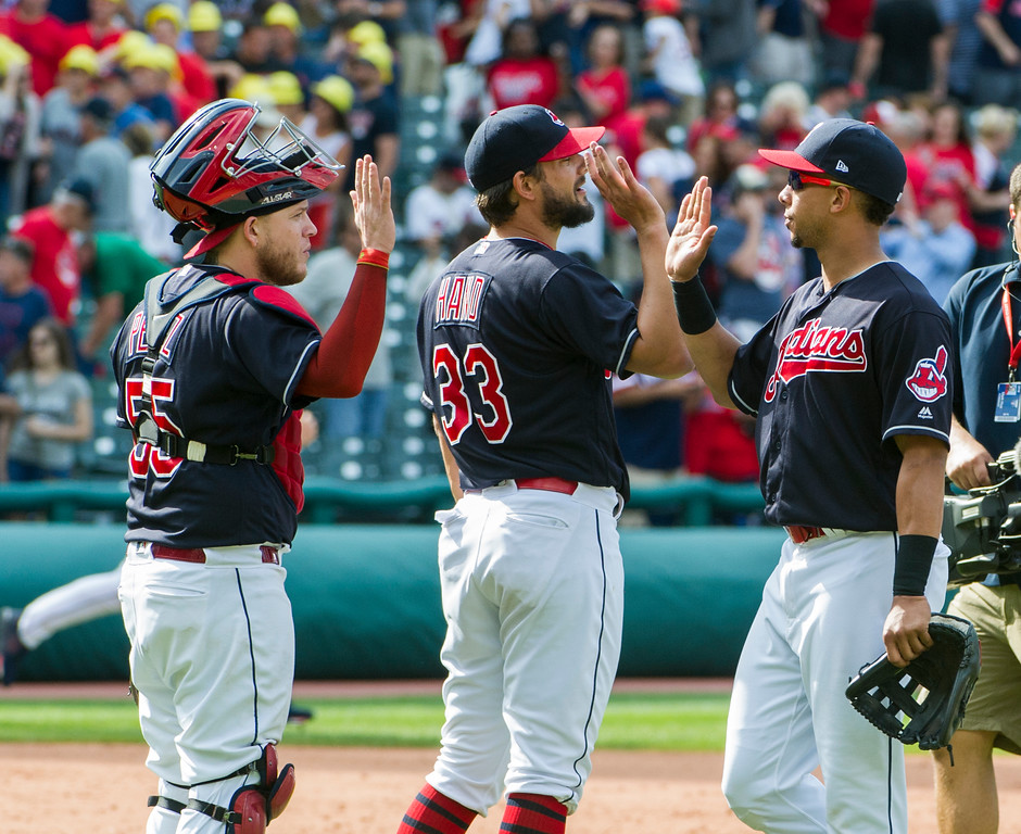 . Cleveland Indians\' Roberto Perez (55), Indians reliever Brad Hand (33) and Michael Brantley celebrate after defeating the Minnesota Twins 5-3 at a baseball game in Cleveland, Thursday, Aug. 30, 2018. Hand got the save to preserve the win. (AP Photo/Phil Long)
