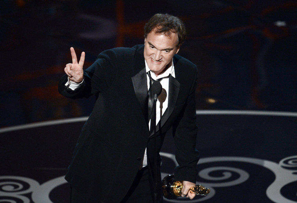 ". Writer/director Quentin Tarantino accepts the Best Writing - Original Screenplay award for ""Django Unchained\"" onstage during the Oscars held at the Dolby Theatre on February 24, 2013 in Hollywood, California.  (Photo by Kevin Winter/Getty Images)"