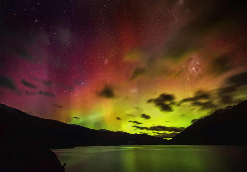 The Solar Storm Hits Queenstown I've been awake for two days.It all started yesterday after I put the kids to bed. I got a Facebook message from Stefan Haworth. It turns out that he and Eden Brackstone were headed out for a little viewing of the big solar storm that was hitting the atmosphere. Down thisaway, it's called the Aurora Australis. Since I've never before seen one (despite countless attempts in Iceland), I was ready to suit up!And it turns out that one of the best places we saw them was right here in Queenstown! I had a decent view from the place I am staying here at The Commonage, but the clouds were pretty heavy. So, we drove down along Lake Wakatipu until we were just past Wye creek. I got out of the car, let my eyes adjust, then saw colored shafts of light shooting up through the edge of our snow-globe. It wasn't like I expected! It's…. hard to explain.- Trey RatcliffClick here to read the rest of this post at the Stuck in Customs blog.