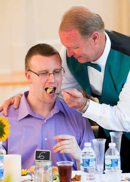 Father of groom feeding guest.jpg