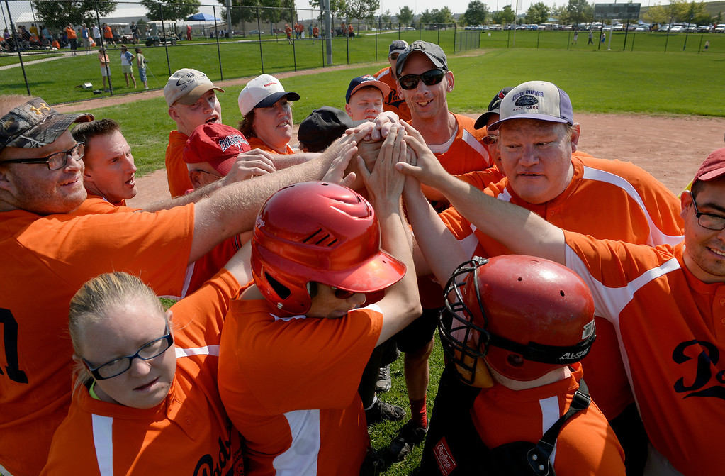 . DENVER, CO. - AUGUST 17: The Colorado Springs Padres celebrate their win over the Parker Power during in the first round of the Special Olympics softball state championship at the Lowry Sports Complex in Denver, CO August 17, 2013. Special Olympics Colorado hosted its state championship in Bocce, Cycling, Golf, Softball and Tennis. Six hundred athletes competed in the events, which was supported by 250 volunteers and coaches. (Photo By Craig F. Walker / The Denver Post)