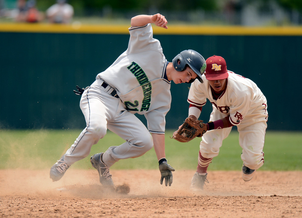 . DENVER, CO. - MAY 25: Dean Lawson of Rocky Mountain HIgh School (12) tagged Josh Brown of ThunderRidge High School (21) during the final round of 5A baseball state championship game at All City Field. Denver, Colorado. May 25, 2013. ThunderRidge won 2-1. (Photo By Hyoung Chang/The Denver Post)