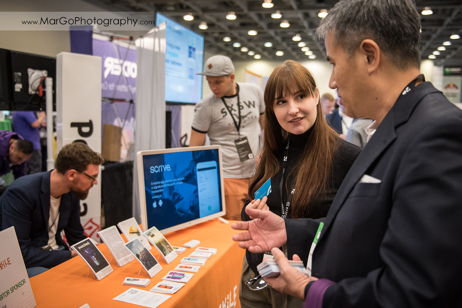 people in front of Polish ICT stand at Disrupt SF at the Moscone Center West in San Francisco