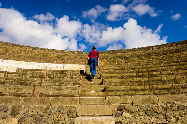 Gabbie walking up the steps of the Pompeii amphitheater