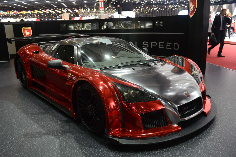 Description of . An Gumpert Apollo S is displayed at the German carmaker's booth during the press day of the Geneva Motor Show in Geneva, on March 5, 2014. (FABRICE COFFRINI/AFP/Getty Images)