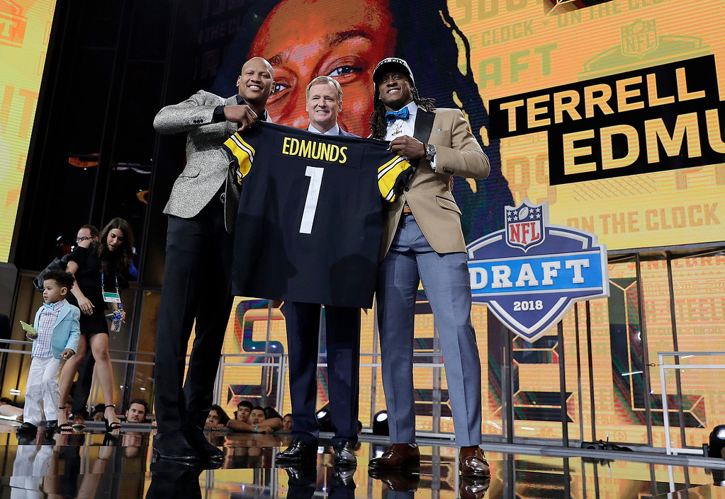. Ryan Shazier, left, poses with commissioner Roger Goodell, center, and Pittsburgh Steelers\' selection Terrell Edmunds, of Virginia Tech, during the first round of the NFL football draft, Thursday, April 26, 2018, in Arlington, Texas. (AP Photo/David J. Phillip)