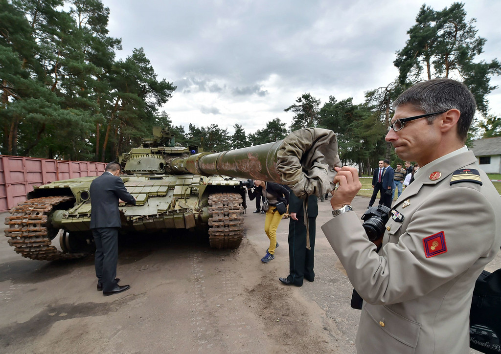 . A military attache examines a Russian T-64BV tank displayed in Kiev on August 29, 2014. Russian weapons and artillery, seized by Ukrainian forces from pro-Russian separatists following clashes in the east of the country, were displayed for inspection by foreign military attaches accredited in Ukraine. Ukraine\'s Prime Minister Arseniy Yatsenyuk said that the government is seeking to join NATO and is submitting a relevant bill to parliament to end its official \'non-bloc\' policy. SERGEI SUPINSKY/AFP/Getty Images