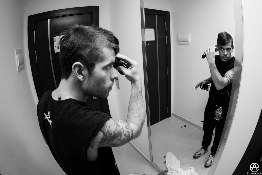 Alex touching up his hawk in our hotel room by Adam Elmakias