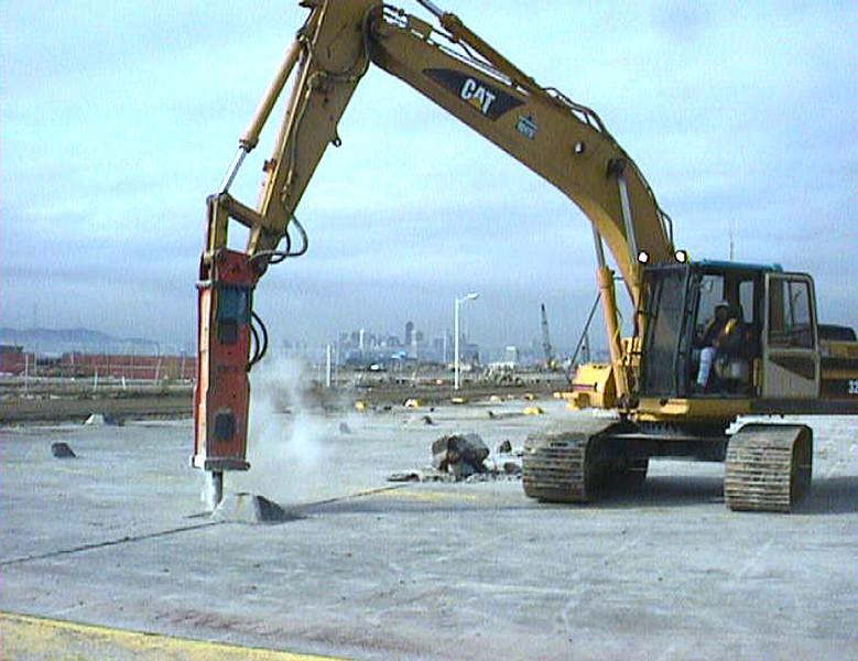 NPK E218 hydraulic hammer on Cat excavator.jpg