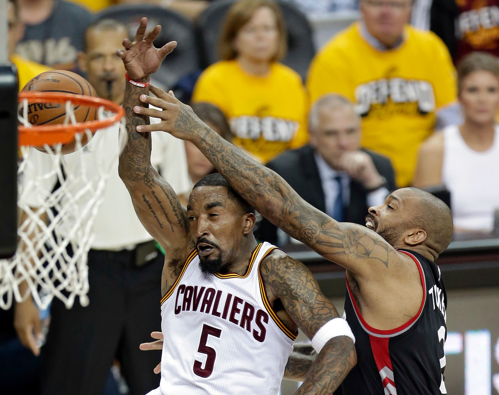 . Toronto Raptors\' P.J. Tucker, right, puts the stop on Cleveland Cavaliers\' J.R. Smith in the first half in Game 1 of a second-round NBA basketball playoff series, Monday, May 1, 2017, in Cleveland. The Cavaliers won 116-105. (AP Photo/Tony Dejak)