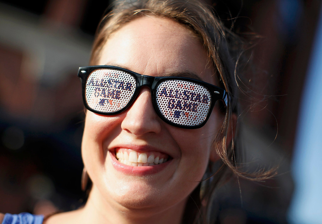 . Baseball fan Erin McCutchen wears All-Star glasses as she arrives for Major League Baseball\'s All-Star Game in New York, July 16 2013. REUTERS/Mike Segar