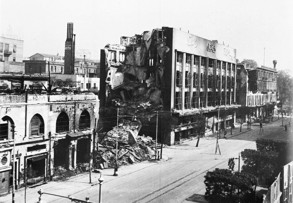. View of the remains of the burnt out \'Cicurel\', Cairo\'s biggest department store, in Cairo, Egypt, Jan. 26, 1952, after it was burnt out the previous day by rioters. The building is on Cairo\'s Fouad First Avenue. (AP Photo)