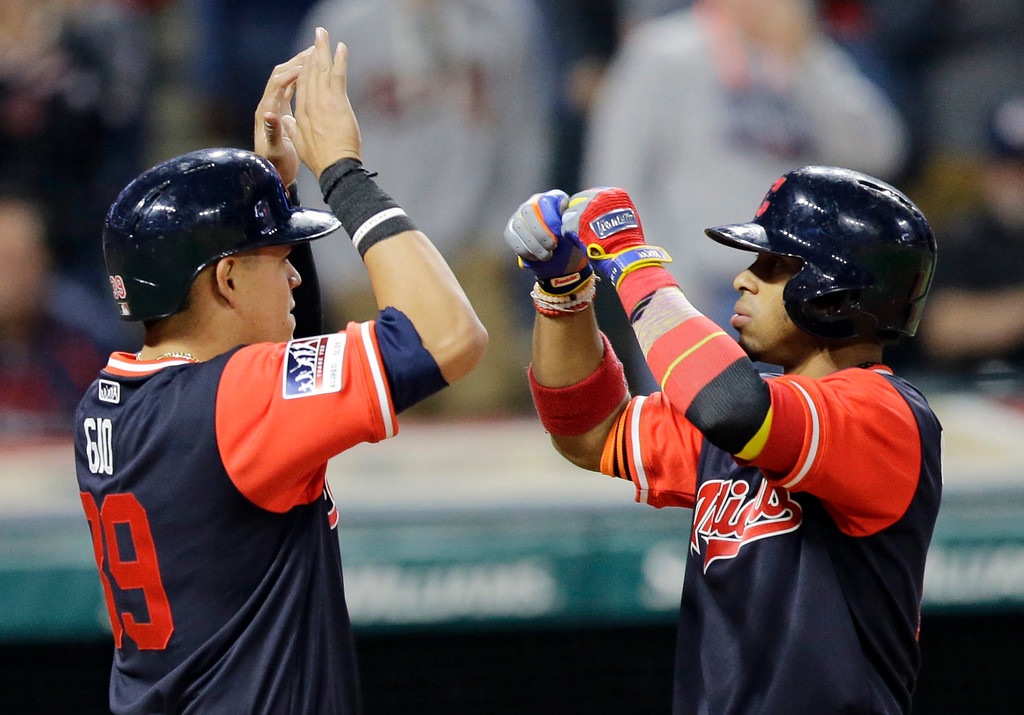 . Cleveland Indians\' Francisco Lindor, right, celebrates with Giovanny Urshela after both scored on a two-run home run hit by Lindor in the fifth inning of a baseball game against the Kansas City Royals, Friday, Aug. 25, 2017, in Cleveland. (AP Photo/Tony Dejak)