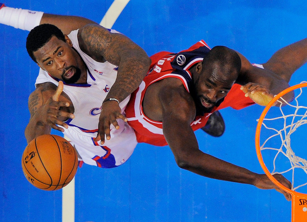 . Los Angeles Clippers center DeAndre Jordan, left, reaches for a rebound against Washington Wizards center Emeka Okafor during the first half of their NBA basketball game, Saturday, Jan. 19, 2013, in Los Angeles.  (AP Photo/Mark J. Terrill)