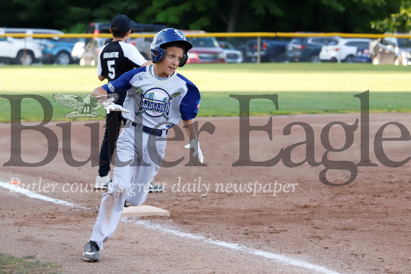 Vinny DeFelice rounds third on his way to score in a 12u game between Saxonburg and Natrona Heights Friday, June 14. Seb Foltz/Butler Eagle