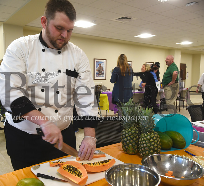 Cliff McClure, certified culinarian in the Butler VA Health Care System, demonstrates how to cut papaya. Photo by Gabriella Canalas