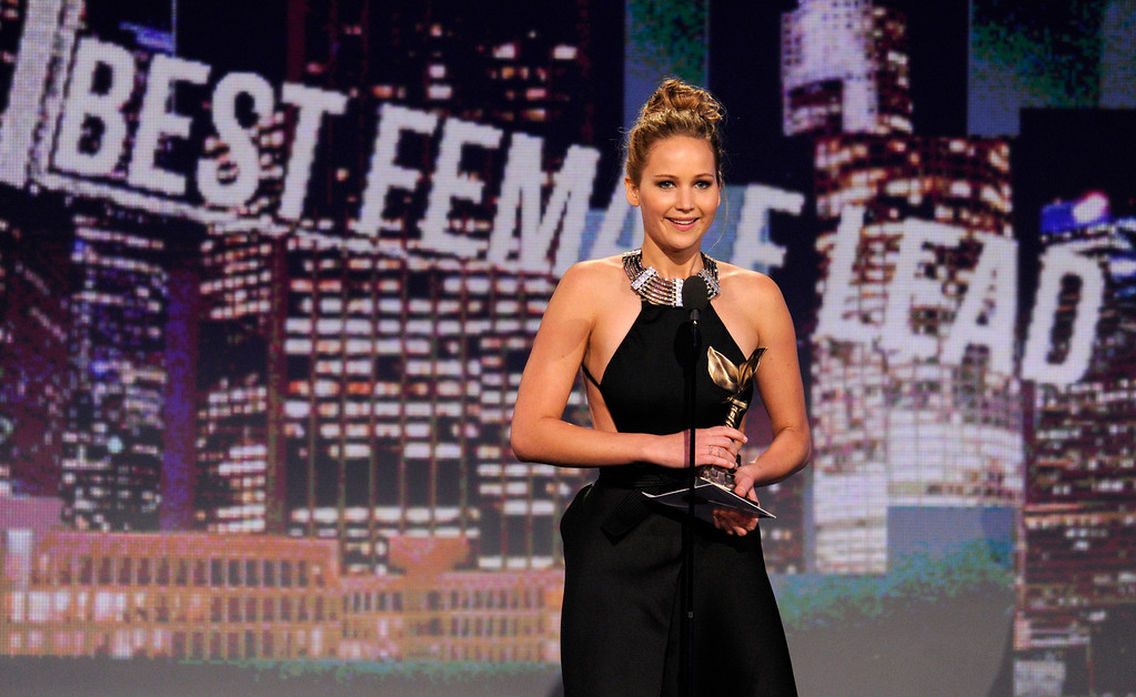 """. Actress Jennifer Lawrence accepts the award for best female lead for \""""Silver Linings Playbook\"""" at the Independent Spirit Awards on Saturday, Feb. 23, 2013, in Santa Monica, Calif. (Photo by Chris Pizzello/Invision/AP)"""