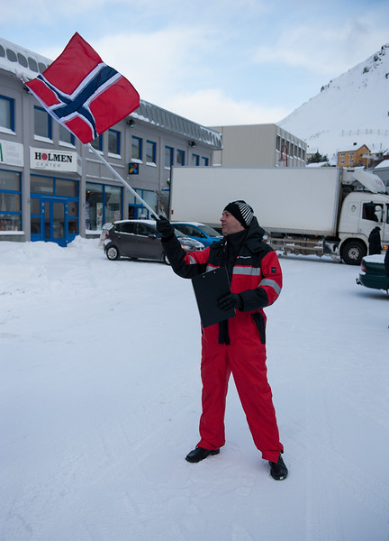 The purser waving the Norwegian flag.