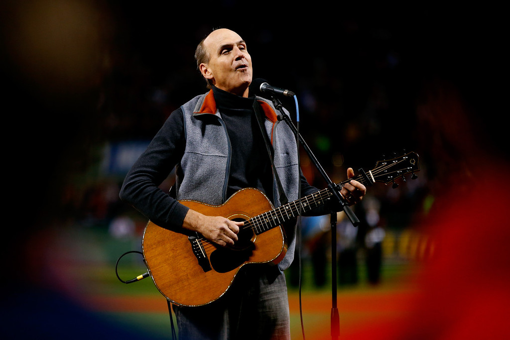 . James Taylor sings the national anthem prior to Game Two of the 2013 World Series between the Boston Red Sox and the St. Louis Cardinals at Fenway Park on October 24, 2013 in Boston, Massachusetts.  (Photo by Jared Wickerham/Getty Images)