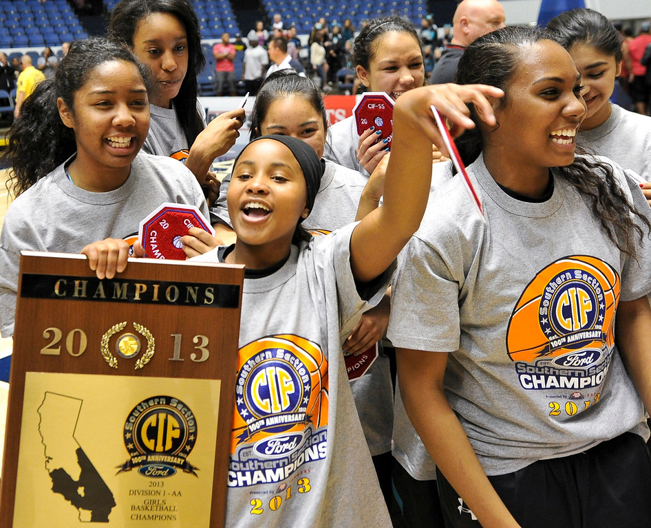 . Santiago High School celebrates after defeating Etiwanda in the CIF-SS Div. I-AA Girls Basketball Championship game at the Anaheim Convention Center on Friday, Mar. 1, 2013. Etiwanda was defeated by Santiago 70-65. (Rachel Luna / Staff Photographer)