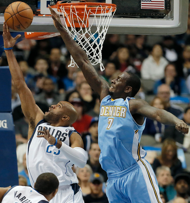 . Dallas Mavericks guard Vince Carter (25) attempts a layup as Denver Nuggets J.J. Hickson (7) defends during the first half of an NBA basketball game Monday, Nov. 25, 2013, in Dallas. (AP Photo/Brandon Wade)