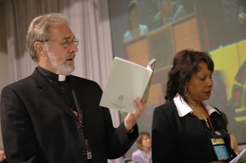 The Rev. Charles Miller and The Rev. Wyvetta Bullock sing after the re-election of Presiding Bishop Mark S. Hanson.